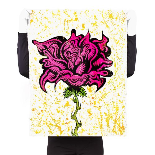 person holding damon johnson rose yellow hand embellished print