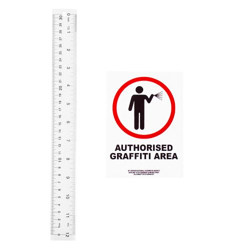 banksy authorised graffiti area sticker shown next to ruler for scale size