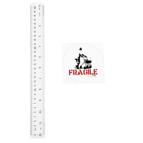 kunstrasen signed fragile sticker next to ruler to show scale
