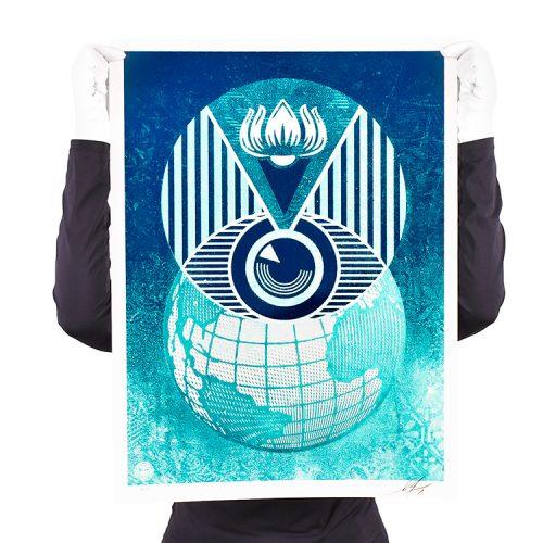 person holding obey shepard fairey flint eye global alert limited edition print