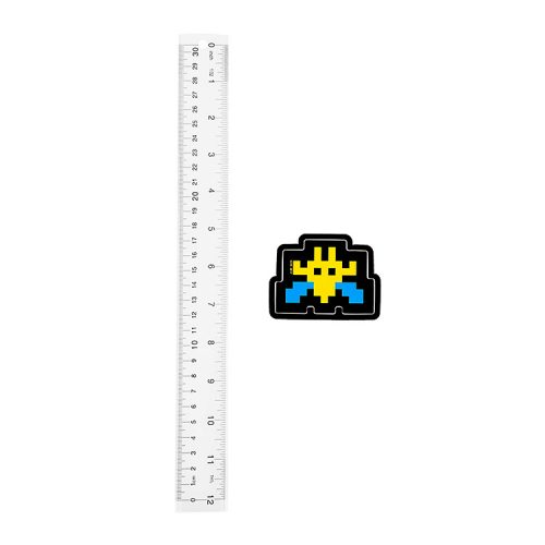 invader blue and yellow invader sticker shown next to ruler for scale