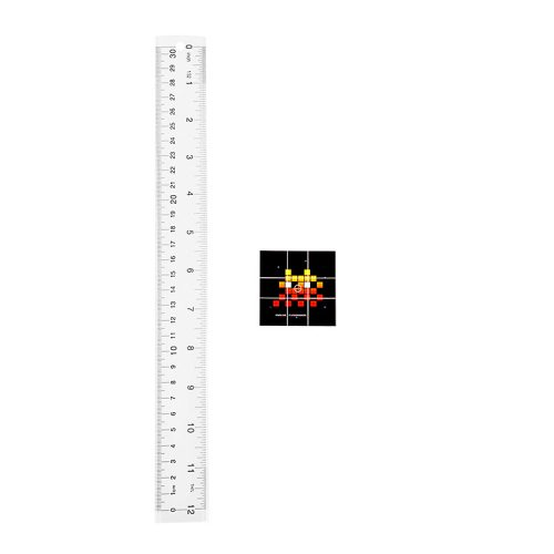 invader flash invaders sticker next to ruler to show scale