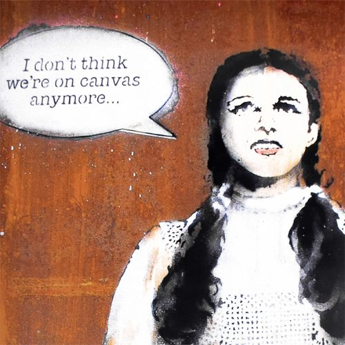 banksy dorothy poster from banksy vs bristol museum show close up with text in speech bubble