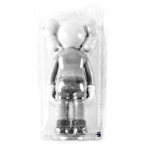 kaws companion grey showing back of sculpture in package with info about it and holographic sticker