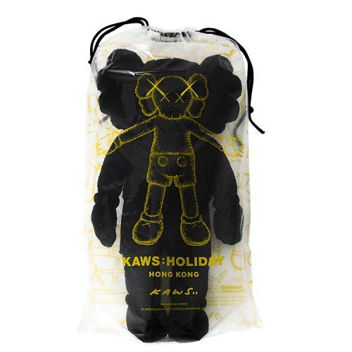 kaws holiday hong kong black plush in packge from front