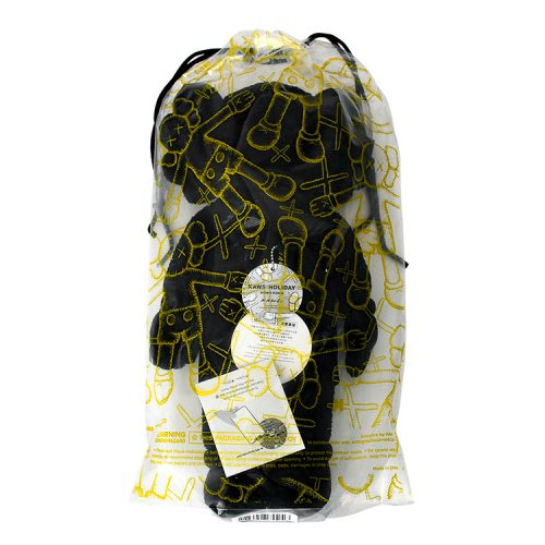 kaws holiday hong kong black plush in package from behind