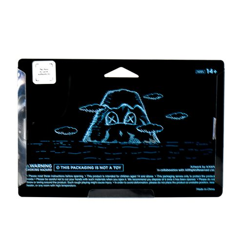 kaws holiday japan vinyl figure in black in sealed package from back