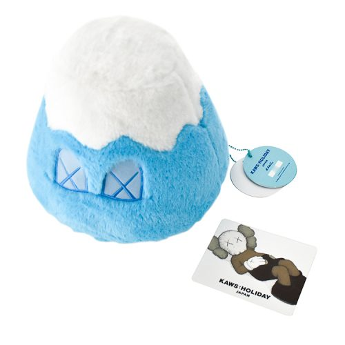 kaws mount fuji blue plush with tag shown with holiday japan info card