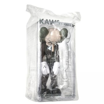 kaws small lie brown in sealed package side view