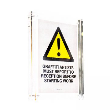 banksy graffiti artists must report to reception sticker in clear frame