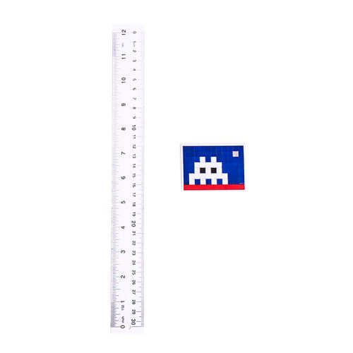 invader home sticker next to ruler for scale