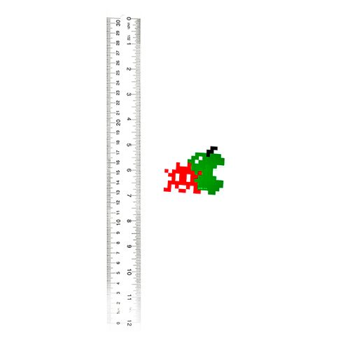 invader apple sticker next to ruler for scale