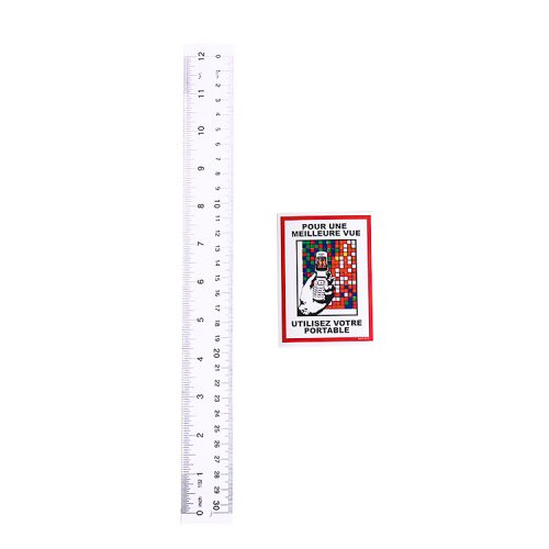 invader qr reader sticker next to ruler for scale