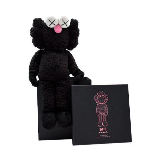 kaws bff plush in black sitting on custom box