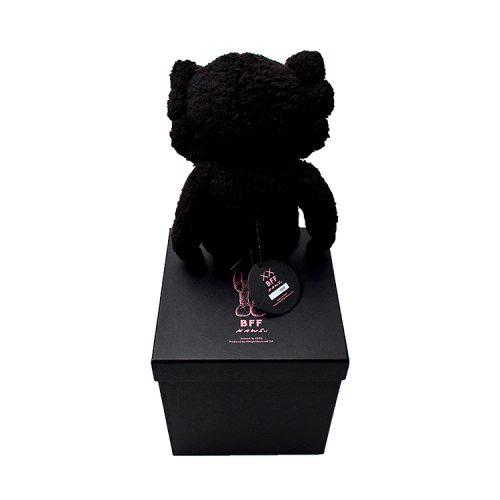 kaws bff plush black shown from behind sitting