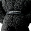kaws uniqlo snoopy plush black small showing close up of kaws tag on neck collar